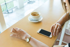 Lifestyle of women using a mobile phone in cafe Stock Photos