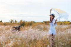 Lifestyle women white dress with vintage bicycle relax and happy summertime in cloudy sunset or sunrise sky in the meadow autumn f royalty free stock images