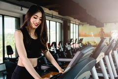 Lifestyle young woman cardio workout running. On treadmill at fitness gym Royalty Free Stock Images