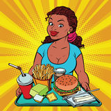 Lifestyle young woman and a fast food lunch in the restaurant Royalty Free Stock Photography