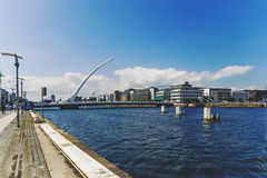 The Liffey river and the Samuel Beckett bridge in Dublin. DUBLIN, IRELAND - 12th July, 2017: view over the Liffey river and the Samuel Beckett bridge in Dublin Royalty Free Stock Images