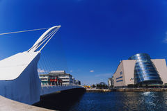 The Liffey river and the Samuel Beckett bridge in Dublin. DUBLIN, IRELAND - 12th July, 2017: view over the Liffey river and the Samuel Beckett bridge in Dublin Royalty Free Stock Photo