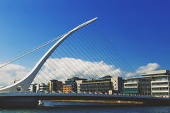 The Liffey river and the Samuel Beckett bridge in Dublin. DUBLIN, IRELAND - 12th July, 2017: view over the Liffey river and the Samuel Beckett bridge in Dublin Royalty Free Stock Image