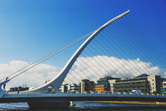 The Liffey river and the Samuel Beckett bridge in Dublin. DUBLIN, IRELAND - 12th July, 2017: view over the Liffey river and the Samuel Beckett bridge in Dublin Royalty Free Stock Photography