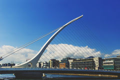 The Liffey river and the Samuel Beckett bridge in Dublin. DUBLIN, IRELAND - 12th July, 2017: view over the Liffey river and the Samuel Beckett bridge in Dublin Royalty Free Stock Photos
