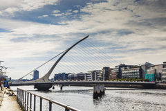 The Liffey river and the Samuel Beckett bridge in Dublin. DUBLIN, IRELAND - 05th July, 2017: view over the Liffey river and the Samuel Beckett bridge in Dublin Royalty Free Stock Photography