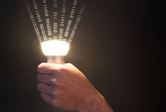 Lifi concept with bulb emitting data and hand. Hand holds a glowing bulb emitting data Royalty Free Stock Photos
