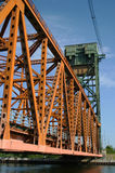 Lift Bridge. An orange and green lift bridge in the down position Stock Images