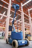 Lift buckets in factory Stock Images