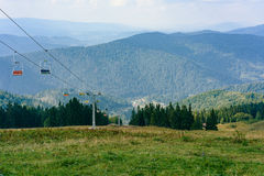 Lift in the Carpathians among spruce trees Stock Photography
