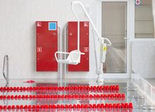 Lift for the descent of people with disabilities into the pool. On a blurred background, a swimming pool is visible royalty free stock photography