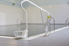 Lift for the descent of people with disabilities into the pool. royalty free stock photos