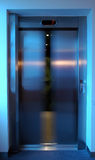Lift door closing. Closing lift doors, white balance set for lift interior, level 7 Royalty Free Stock Image