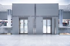 Lift doors on a top storey. In a business center royalty free stock photo