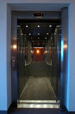 Lift with mirror. Open stainless elevator with mirror, mirror reflects orange wall, level 7 Stock Images