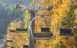 Lift seats in the sky. Lift seats in autumn, before skiing season stock photo