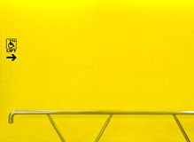 Lift sign for disabled on yellow wall with handrail Royalty Free Stock Photography