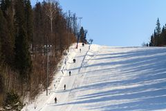 Lift for skiers and snowboarders in the winter day and slope for skiing royalty free stock photo