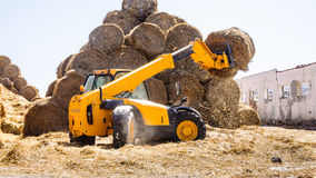 Lift tractor farm straw bales Royalty Free Stock Photo