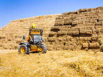 Lift tractor farmer worker straw bales Stock Photography