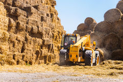 Lift tractor working farm straw bales Royalty Free Stock Images