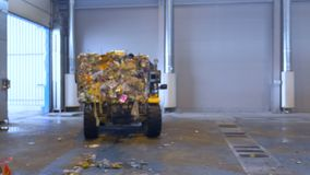 Lift truck, forklift loading a pile of trash on a truck. Special machinery working. 4K stock footage