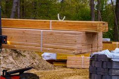 Free Lift Truck Moving A Stack Of 2 X 4 Lumber Studs At A Small Log Processing Royalty Free Stock Photos - 146980478