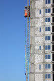 Lift on wall of under construction building Stock Photo