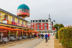 Lifted cafe at the promenade in Zinnowitz, Usedom, Germany. Zinnowitz, Germany - October 24, 2017: lifted cafe at the promenade with unidentified people Royalty Free Stock Image