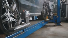 Lifted car in professional service - the collapse of convergence - process repairing Stock Image