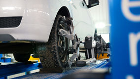 Lifted car in professional service - the collapse of convergence - process repairing Royalty Free Stock Images