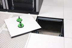 Lifted Datacenter Floor Tile With Vacuum Suction Cups In Datacenter. High angle view of lifted floor tile with vacuum suction cups in datacenter Stock Photography