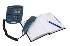 Lifted telephone tube, diary. Telephone with lifted telephone tube, blue-black pen and open diary stock photography