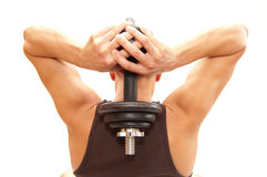 Lifting it. Athlete lifting a heavy weight behind his back Royalty Free Stock Image