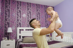 Lifting baby Stock Images