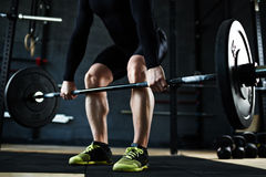 Lifting barbell in gym Stock Photo