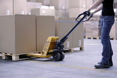 Lifting boxes with forklift royalty free stock photography