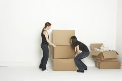 Lifting boxes into a room Royalty Free Stock Image