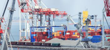 Lifting cargo cranes, ships and grain dryer in Sea Port stock photo