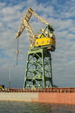 Lifting cargo cranes at the shipyard in Bay of Black Sea. Royalty Free Stock Images
