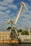 Lifting cargo cranes at the shipyard in Bay of Black Sea. Royalty Free Stock Image