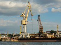 Lifting cargo cranes at the shipyard in Bay of Black Sea. Stock Image