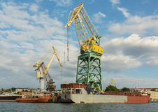 Lifting cargo cranes at the shipyard in Bay of Black Sea. Stock Images