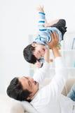 Lifting child Stock Photos