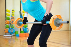 Lifting concept -woman exercising with barbell in gym Royalty Free Stock Image