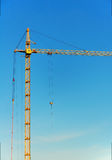 Lifting construction crane. At blue sky Royalty Free Stock Images