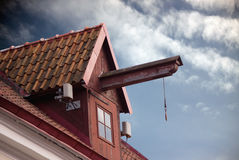 Lifting construction on old house roof Stock Image