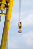 Lifting crane. Detail from a lifting crane with blue sky in the background Royalty Free Stock Images