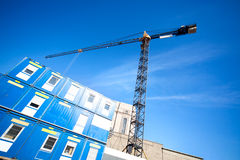 Lifting crane on building Stock Photo