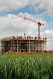 Lifting crane on the building in construction Stock Photography